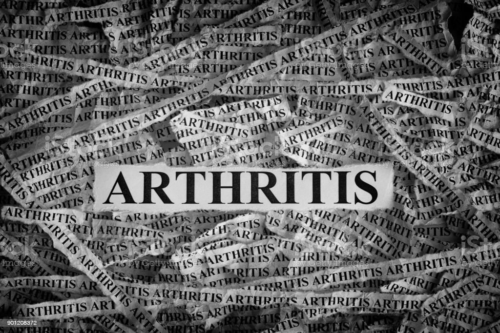 Torn pieces of paper with word Arthritis stock photo