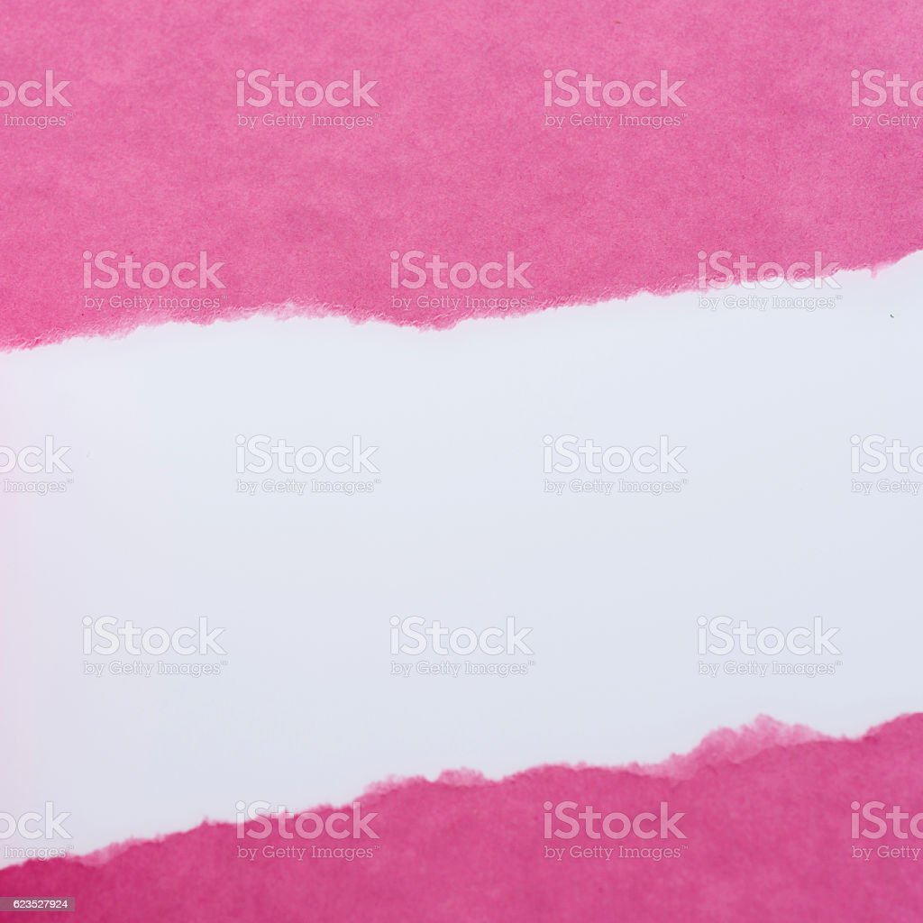 Torn pink paper on white background stock photo