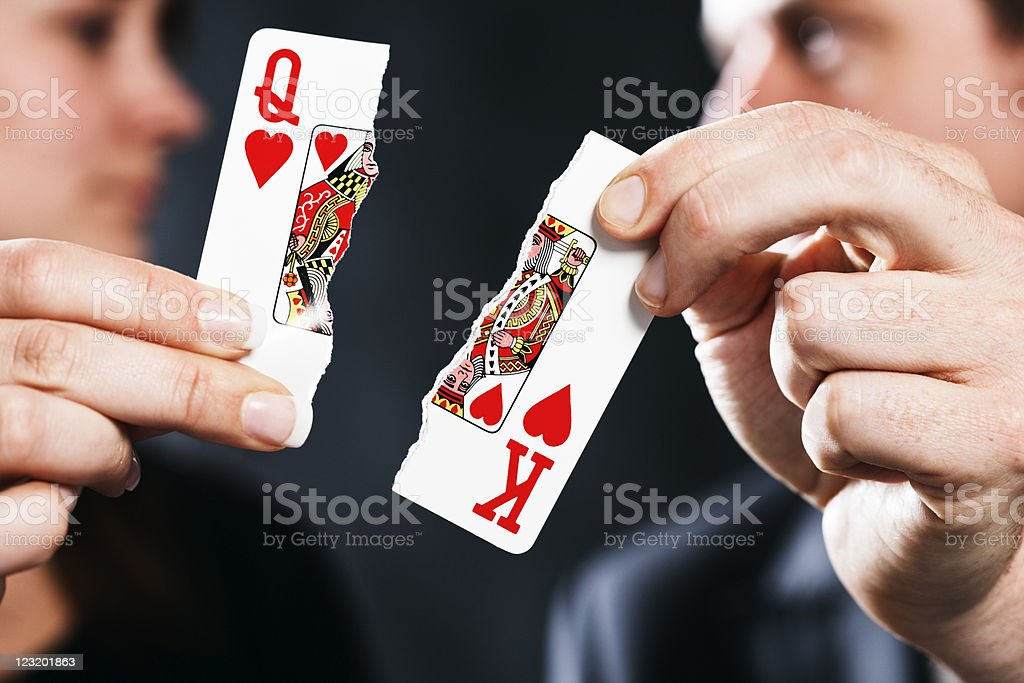 Torn playing cards symbolize divorce royalty-free stock photo