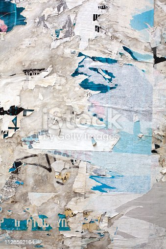 Close up of torn posters in Athens, Greece.