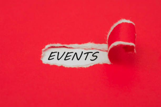 Torn red paper revealing the word events. Upcoming events concept stock photo