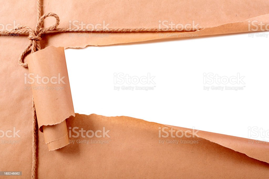 Torn section of a brown paper wrapped package stock photo