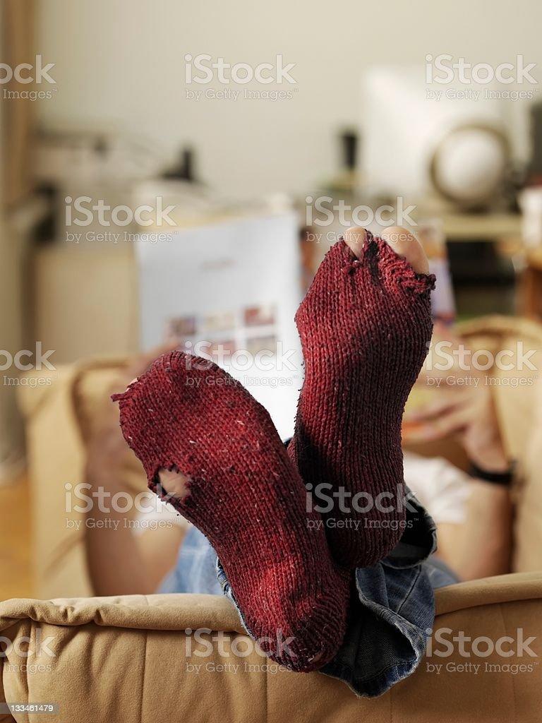 Torn stocking feet royalty-free stock photo