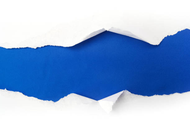 torn white paper on blue background. Cocept for autism awareness day. Break barriers together for autism stock photo