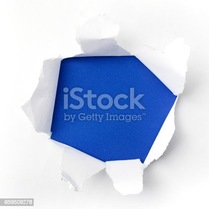 istock torn white paper on blue background. Cocept for autism awareness day. Break barriers together for autism 659509278
