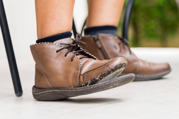 torn women leather boots stock photo