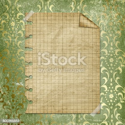 istock Torn yellow paper fastened with masking tape. Old parchment 500366653
