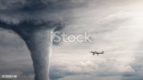 Tornado view - horizontal image with air plane near tornado. Nature power concept. Climate change. Weather illustration. Adventure travel conceptual photography.