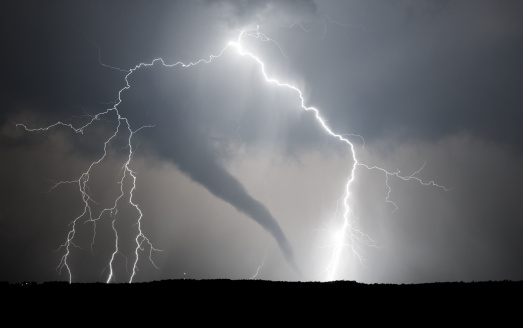 A powerful thunderstorm producing a tornado and lightning.
