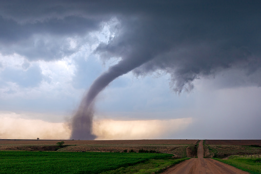 A tornado funnel spins beneath a supercell thunderstorm during a severe weather event near McCook, Nebraska.