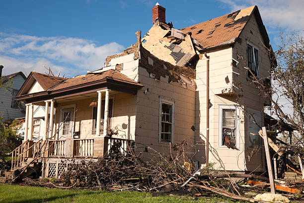 Tornado battered home severely damaged.  knocked down stock pictures, royalty-free photos & images