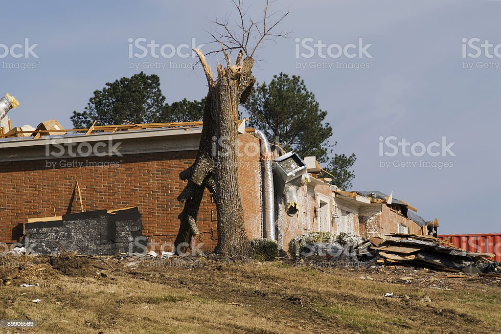 tornado damaged house with a broken tree in the foreground royalty-free stock photo