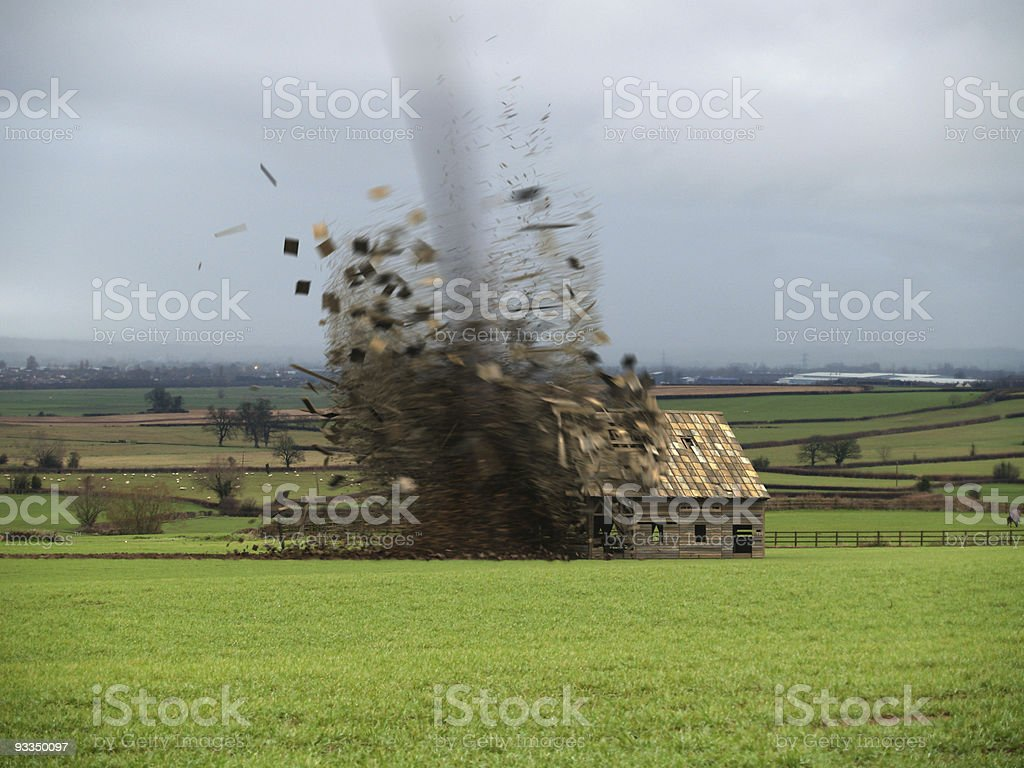 Tornado Destroying Barn stock photo