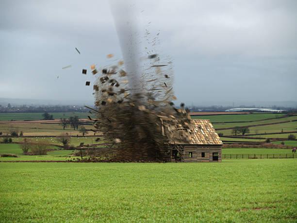 tornado destroying barn - tornado stockfoto's en -beelden