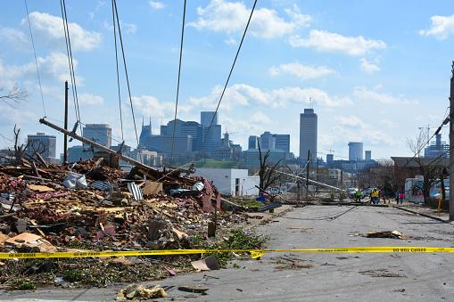 Nashville, Tennessee, 2020: The Nashville city skyline creates a backdrop to the tornado destruction in the nearby Buena Vista neighborhood.