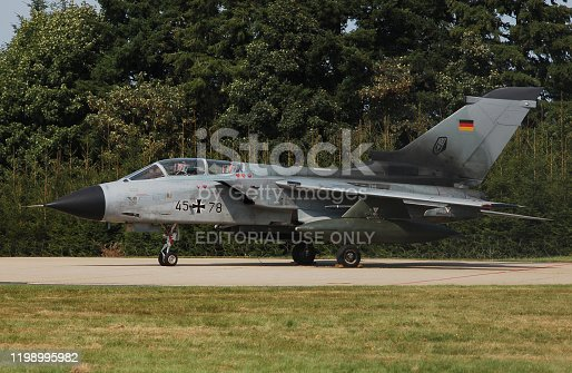 istock Tornado from the German air force stay in front of a harded aircraft shelter at Büchel airbase, Germany 1198995982