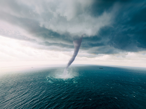 Abstract Concept of a Hurricane or Tornado Vortex Funnel of Particles of Dust, Debris, and Trails