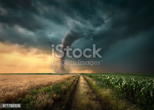 istock Tornado struck on agricultural fields at sunset 671793326