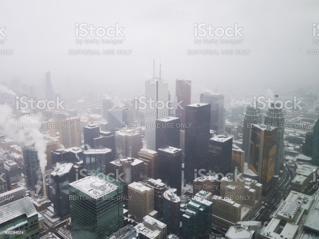 Toronto, Canada snowfall panoramic city view from CN tower observation deck. stock photo