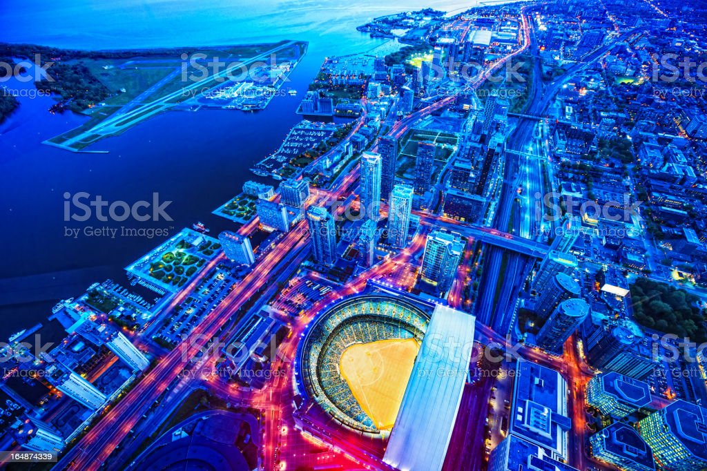 Toronto cityscape with baseball stadium at dusk stock photo