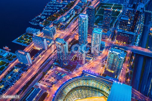 Toronto cityscape with baseball stadium at dusk, Ontario, Canada.