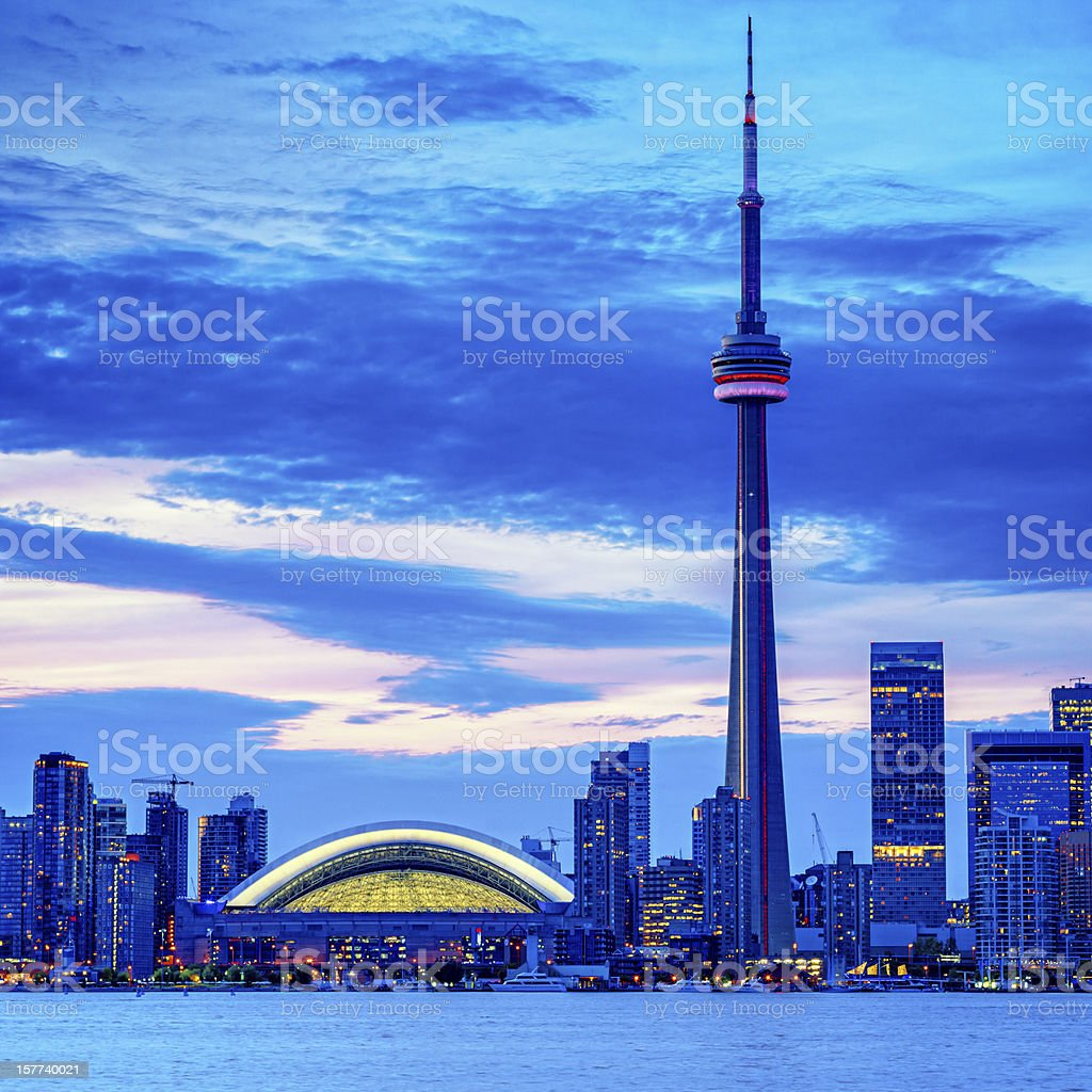 Toronto cityscape with CN Tower and baseball stadium at dusk stock photo