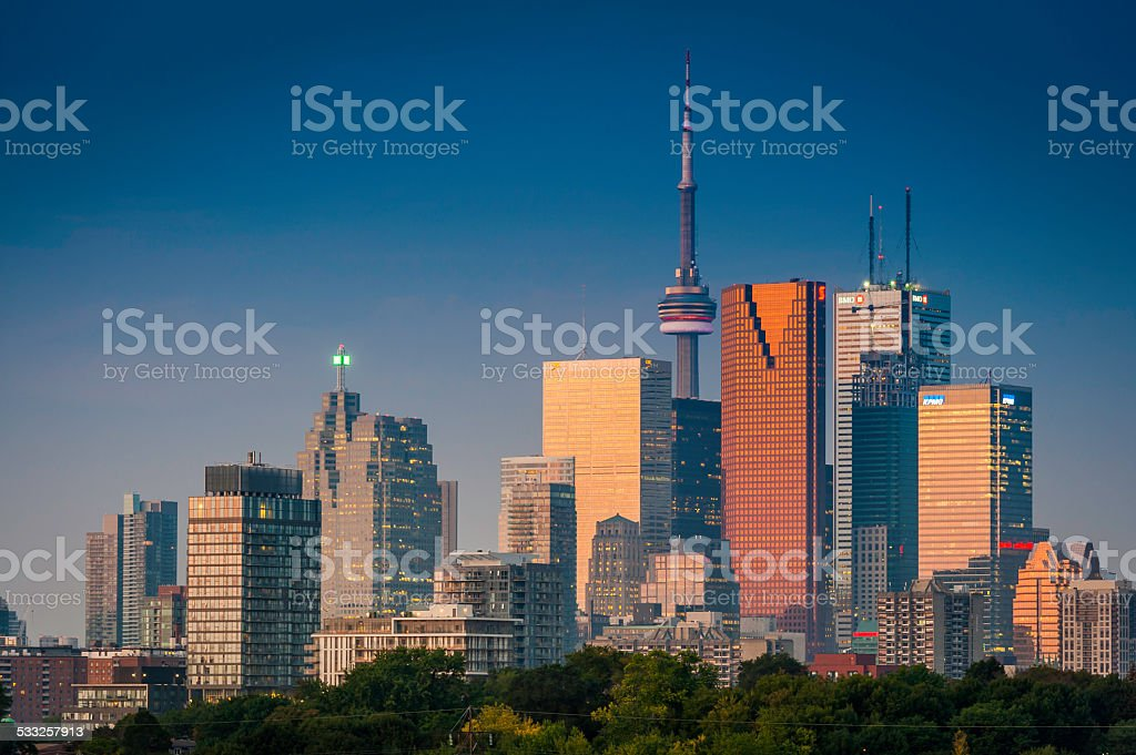 Toronto CN Tower and downtown skyscrapers illuminated at sunset Canada stock photo