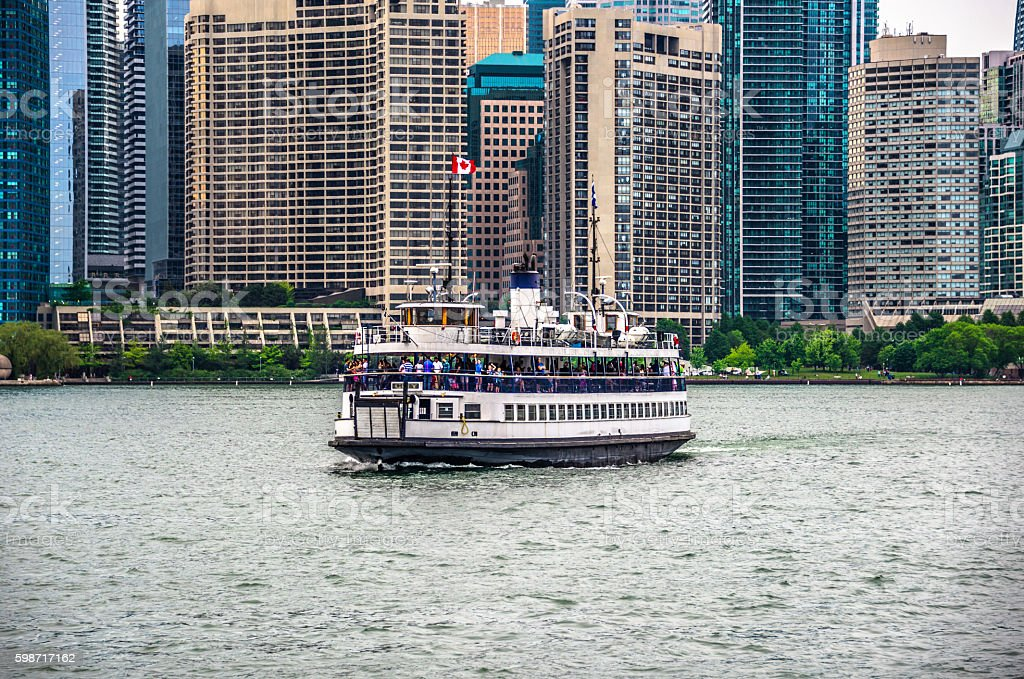 Toronto Island Ferry with City Skyline in Background stock photo