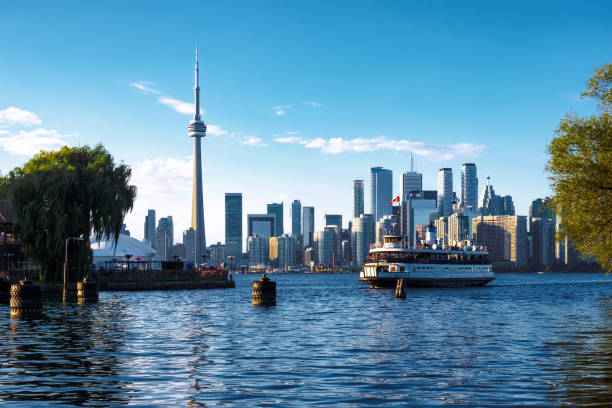 Toronto, Ontario, Canada, View of Toronto Skyline Showing Ferryboat Arriving at Centre Island By Day in Fall Season stock photo