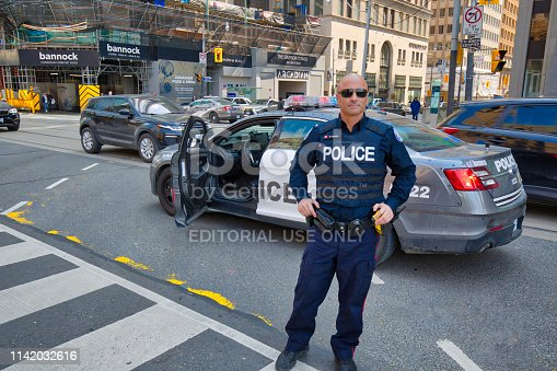 Toronto, Canada-April 10, 2019: Toronto Police Force safeguarding protests in Toronto downtown and Nathan Phillips square