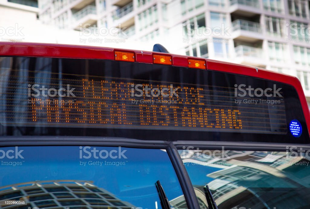 Toronto Public Transportation during Covid-19 pandemic. Rear door boarding rule rules implemented to limit social distancing Toronto Public Transportation during Covid-19 pandemic. Rear door boarding rule rules implemented to limit social distancing Biohazard Symbol Stock Photo