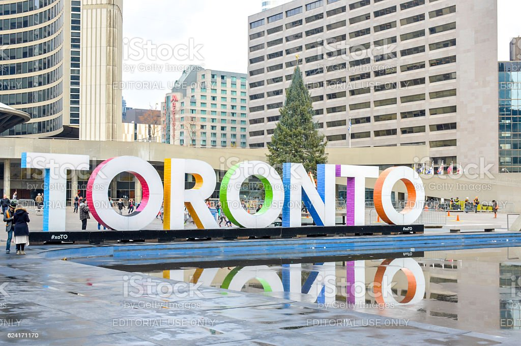 Toronto sign and Nathan Phillips Square in Toronto stock photo