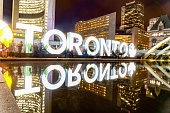 Tourists are enjoying Nuit Blanche at City Hall - Nathan Phillips Square in Toronto,Canada (a sleepless night).