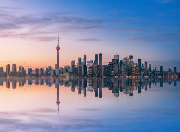 Toronto Skyline at sunset with reflection - Toronto, Ontario, Canada Toronto Skyline at sunset with reflection - Toronto, Ontario, Canada canada stock pictures, royalty-free photos & images