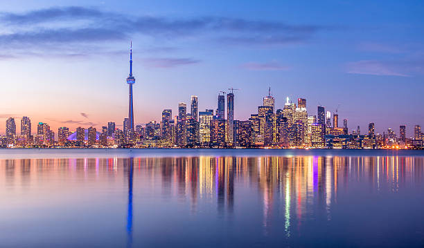 toronto skyline with purple light - toronto, ontario, canada - canada stockfoto's en -beelden