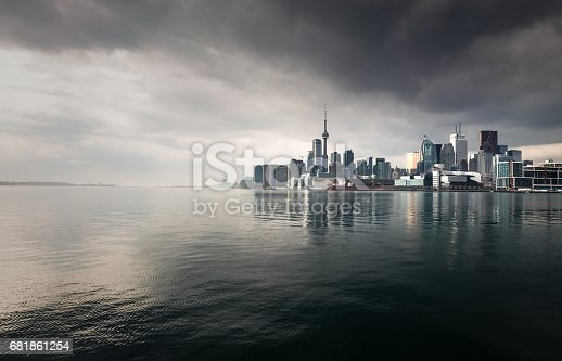 Toronto's CBD, seen across the water with a stormy, overcast sky.