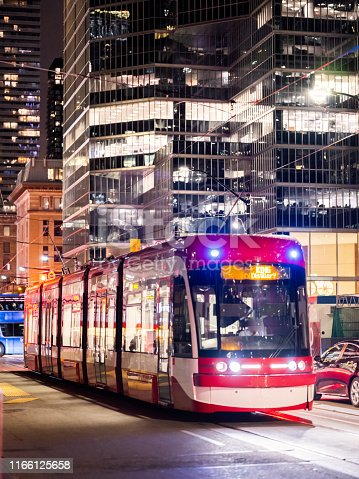 A Street Car navigates down King Street in Downtown Toronto.