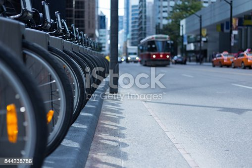istock Toronto streetcar and taxis on busy street bike rental station public transport 844238786