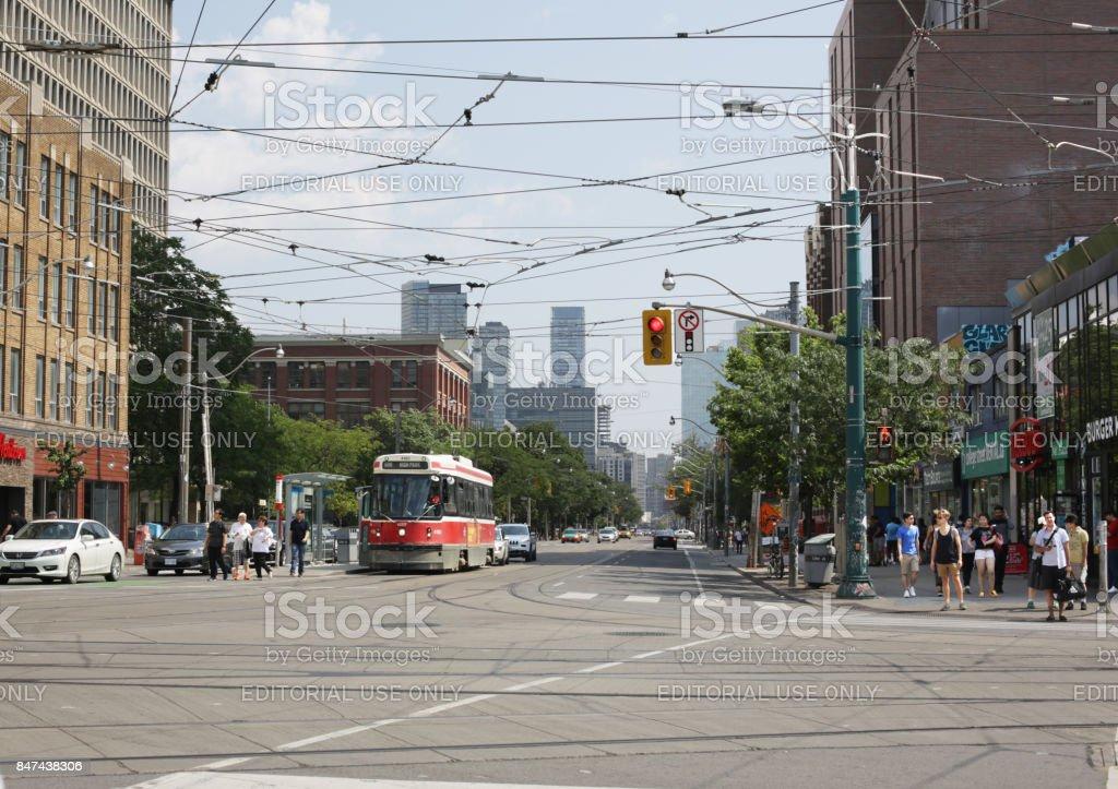 Toronto Streetcar on College Street at Spadina Avenue stock photo