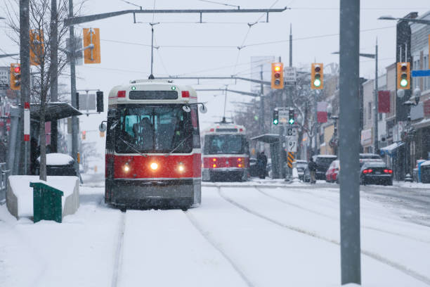 toronto streetcar under snow - toronto streetcar stock photos and pictures