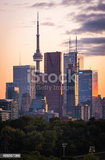 Warm sunset skies over the the landmarks of downtown Toronto, the CN Tower, business skyscrapers and high rise condominums windows shining with golden light. ProPhoto RGB profile for maximum color fidelity and gamut.