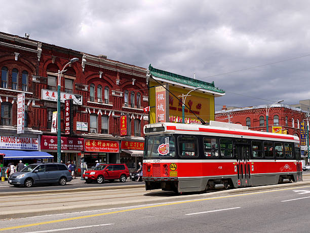 toronto's chinatown - toronto streetcar stock photos and pictures