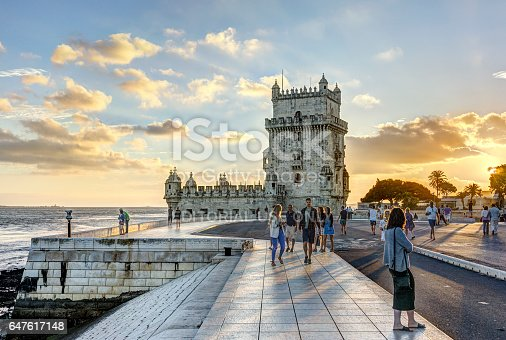 Lisbon, Portugal - August 30,02016: Pedestrians at Torre de Belem at sunset.