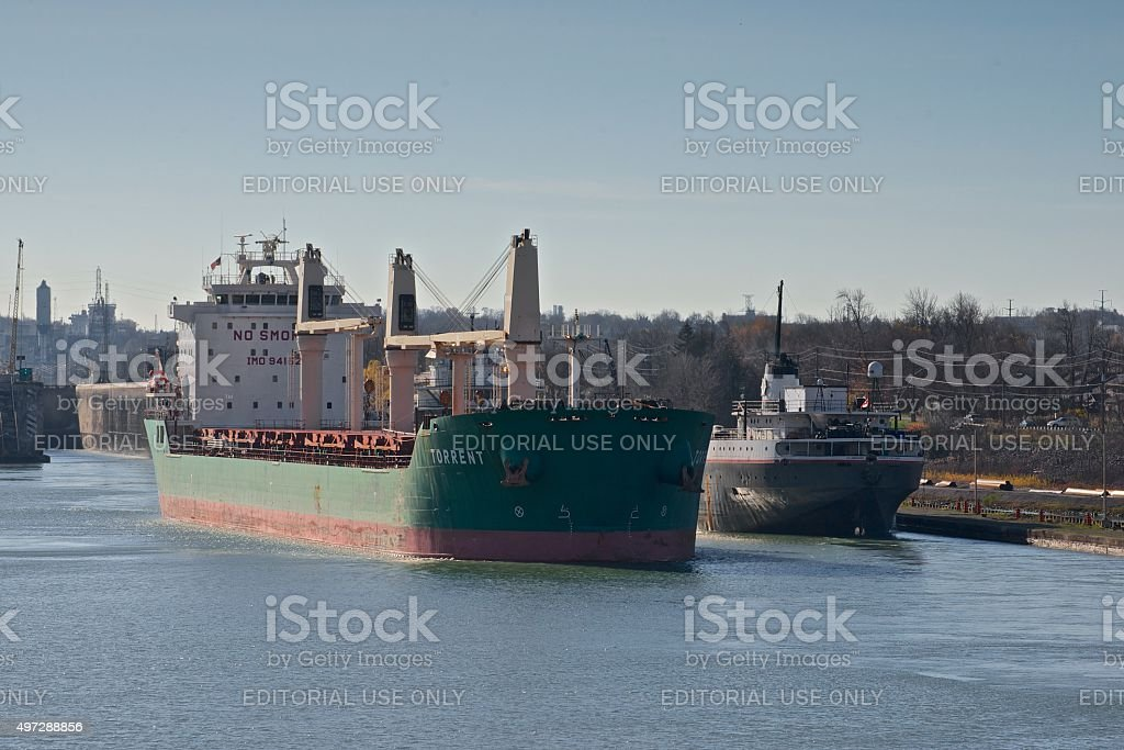 Torrent and Ojibway lake freighters navigating the Welland Canal stock photo
