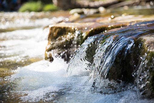 Small waterfall in a torrent, shallow depth of field