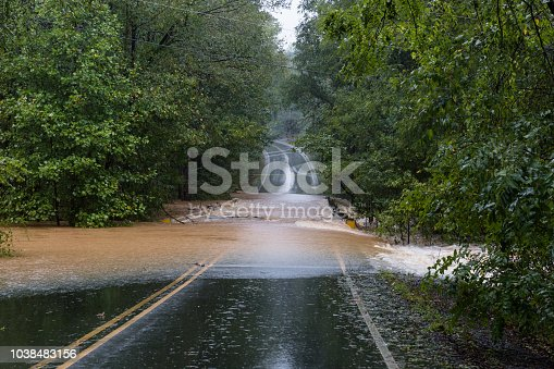 Waxhaw, North Carolina - September 16, 2018: Rainwater from Hurricane Florence washes out a bridge