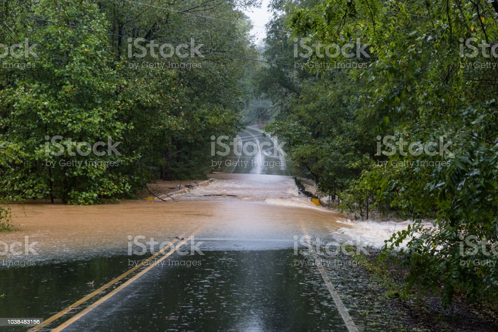 Torrential rain floods a road stock photo