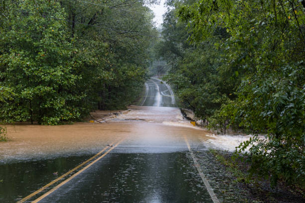 Torrential rain floods a road stock photo