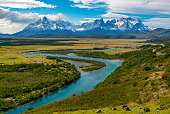 Landscape photograph of the Torres and Cuernos of the Paine Massif and Serrano river inside Torres del Paine national park, Patagonia, Chile.