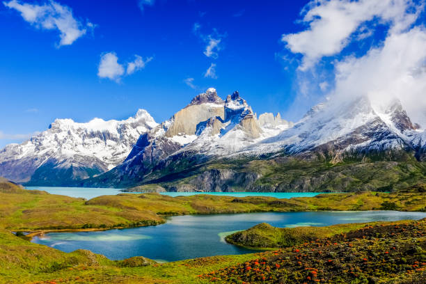 Torres del Paine, Chile. Beautiful Patagonia landscape of Andes mountain range, winding road and lake at Torres del Paine National Park, Chile. chile stock pictures, royalty-free photos & images